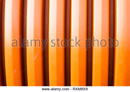 Plastic background in orange color. - Stock Image