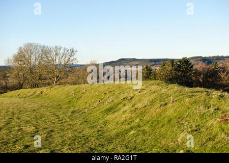 Leintwardine, Herefordshire, UK. The vallum (earth rampart) around the nearby Roman fort of Brandon Camp (Branogenium), once an Iron Age hill fort - Stock Image