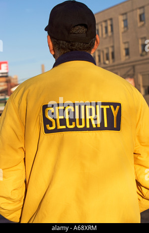 SECURITY SIGN ON JACKET, SAFETY, WARNING, CAREFUL, SECURITY GUARD, COMFORT - Stock Image