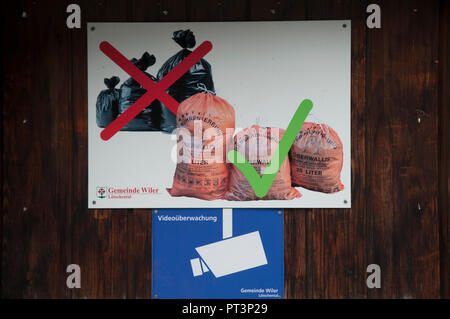 Garbage dispoal instructions displayed in a village in the Loetschental valley, Valais, Switzerland: approved, fee-paid bags must be used. - Stock Image