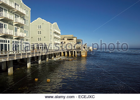 Monterey Bay on a sunny morning with Cannery Row hotels in the foreground. - Stock Image