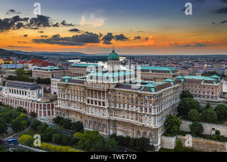Budapest, Hungary - Aerial view of the beautiful Buda Castle Royal Palace at sunset with Parliament Building and the skyline of Budapest at background - Stock Image