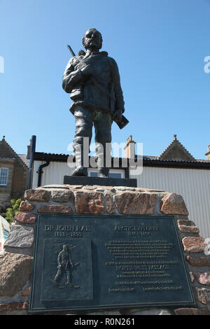 The bronze statue of the Arctic explorer Dr John Rae at the pierhead in Stromness, Orkney, Scotland - Stock Image