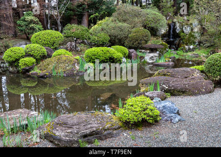 Jiunji Temple Pond Garden - Jiunji Temple is blessed with a variety of growth: pine, cherry blossoms as well as a dry rock garden and moss which highl - Stock Image