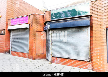 Window shutters, shuttered up shops, security shutters, Scunthorpe Town, Lincolnshire UK England - Stock Image