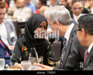 Congresswoman Ilhan Omar of Minnesota's 5th Congressional District talks to Austin Mayor Steve Adler at the annual city-wide iftar dinner in honor of the 14th day of Ramadan. Omar was joined by Adler, a Jew, to call for peace and harmony in today's divisive climate. - Stock Image