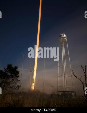 A long exposure showing the Northrop Grumman Antares rocket, with Cygnus resupply spacecraft onboard, blasting off from Pad-0A at the NASA Wallops Flight Facility April 17, 2019  in Wallops, Virginia. The commercial resupply cargo mission will carry 7,600 pounds of science and research, crew supplies and vehicle hardware to the International Space Station. - Stock Image