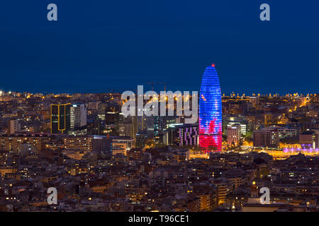Scenic aerial view of Barcelona city skyscraper and skyline at night in Barcelona, Spain. - Stock Image