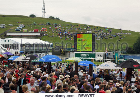 Spectators and bookies at horse race meeting. - Stock Image