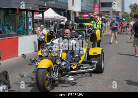 Bournemouth, UK. 24th June, 2018. People get into the swing of things with the vibrant Metropole Mardi Gras street festival in central Bournemouth. A free event on Holdenhurst Road in Lansdowne, including a Mardi Gras parade and live music. Credit: Thomas Faull/Alamy Live News - Stock Image