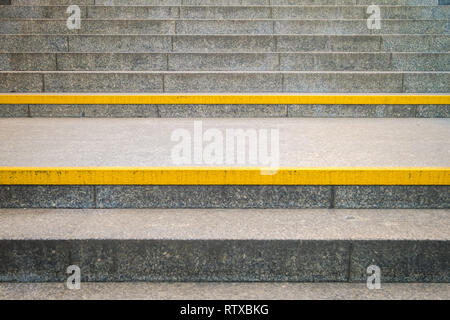 yellow warning line on stairway, urban signage example, Warsaw, Poland - Stock Image