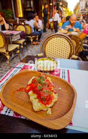 Traditional Romanian meal of meatballs with tomato sauce and mashed potatoes, Taverna Kovaci, Old city, Bucharest, - Stock Image