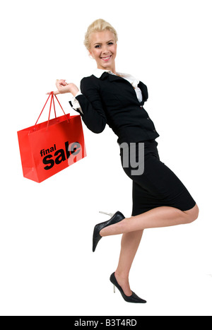 happy lady with shopping bag on isolated background - Stock Image
