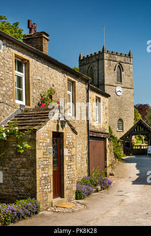 UK, Yorkshire, Wharfedale, Kettlewell, St Mary's Church from stone porch of Bridge House - Stock Image