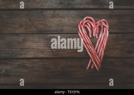 Candy canes making Valentine heart shape - Stock Image