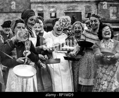 ** This is a low res scan. If you require the hi res image please email the reference number to desk@mirrorpix.com **    Housewives toss their pancakes at the start of the Olney Pancake Race  2/3/49 - Stock Image