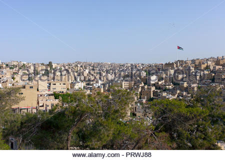 Jordan flag in Amman City - Stock Image