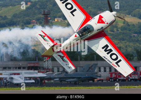 Acrobatic flying sideways very low above ground, Airshow Maribor 2008, Slovenia June 15, 2008 - Stock Image