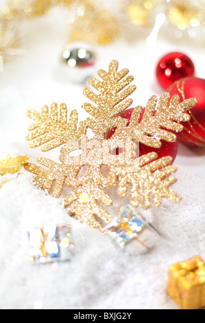 Christmas decoration with baubles,gift boxes and golden snowflake - Stock Image