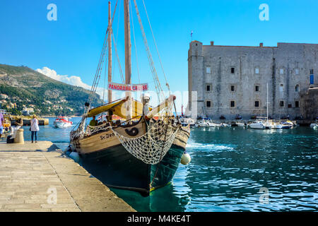 A tour boat similar to a pirate ship docks in the Dubrovnik Harbour, Croatia on the Dalmatian Coast of the Adriatic - Stock Image