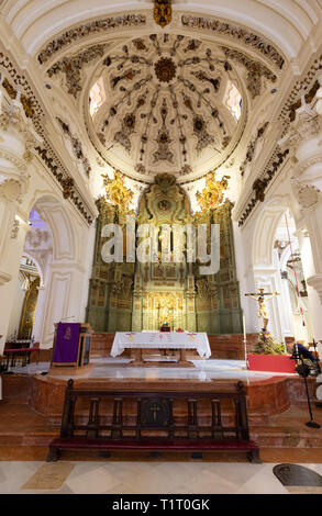 The nave in the interior of the Iglesia de Santiago (Church of Santiago), the oldest Roman Catholic church in Malaga, Andalucia, Spain Europe - Stock Image