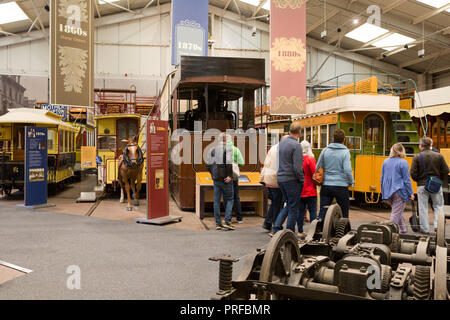 Visitors on a tour of the National Tramway Museum, Crich, Derbyshire, UK unsharpened - Stock Image