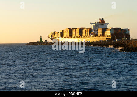 Container ship Al Hilal Monrovia  passing south mole as it leaves Fremantle harbour, Fremantle, Western Australia - Stock Image