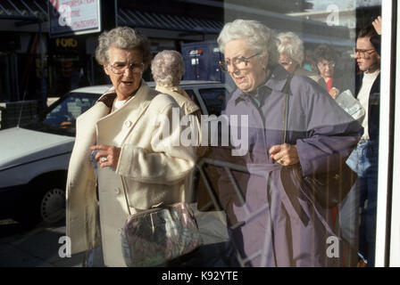Elderly women out and about shopping - Stock Image