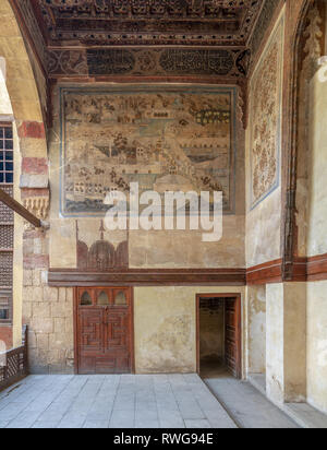 Stone wall decorated with mural depicting Istanbul city at ottoman historic Beit El Set Waseela building (Waseela Hanem House), Old Cairo, Egypt - Stock Image