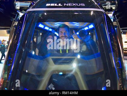 Bell Nexus 'Flying Car' hybrid-electric vertical takeoff and landing (eVTOL) taxi on display in their exhibit booth at CES, Las Vegas, USA. - Stock Image
