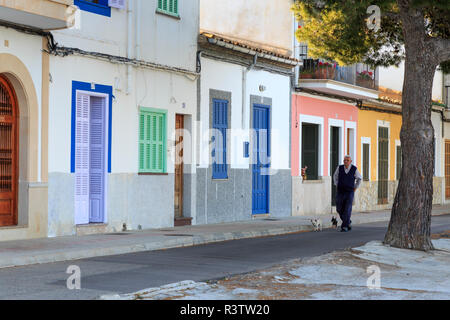 Spain, Balearic Islands, Mallorca. Porto Colom. Man walking his two small dogs. (Editorial Use Only) - Stock Image