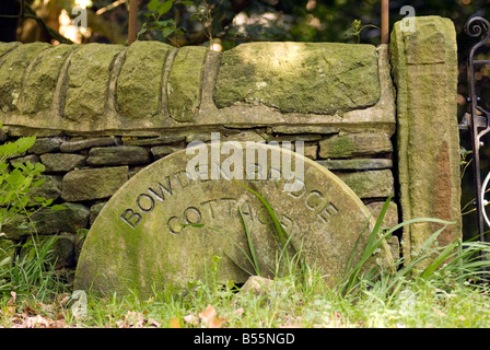 Millstone sign in the Peak District National Park Derbyshire UK England GB Great Britain - Stock Image