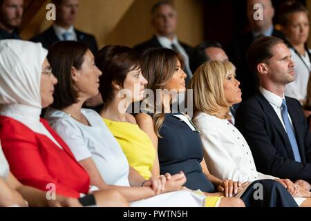U.S First Lady Melania Trump sits with spouses during a music program on the sidelines of the NATO Summit at the Queen Elisabeth Music Chapel July 11, 2018 in Waterloo, Belgium. Sitting left to right are: Emine Erdogan, Ingrid Schulerud, Amelie Derbaudrenghien, Melania Trump, Brigitte Macron and Gauthier Destiny. - Stock Image
