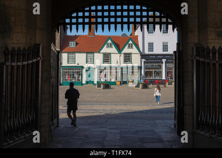 Bury St Edmunds town, view from the medieval Abbey Gate towards shops sited on Angel Hill in the centre of Bury St Edmunds, Suffolk, UK. - Stock Image