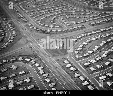 1950s AERIAL OF HOUSING DEVELOPMENT WITH CHURCH BEING BUILT ON CENTRAL INTERSECTION LEVITTOWN PENNSYLVANIA USA - a59 KRU001 HARS OLD FASHIONED - Stock Image