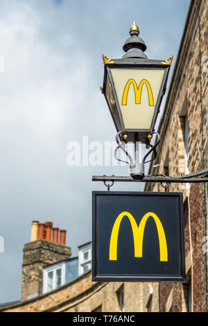 Mcdonalds golden arches on Victorian styled lamppost on Rose Crescent in Cambridge city centre. Cambridgeshire, England, UK. - Stock Image