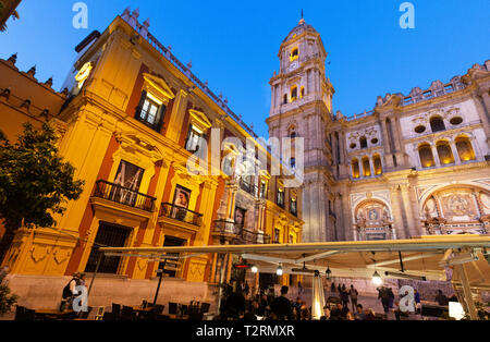 Malaga Cathedral and the Bishops Palace lit up at night, seen from the Plaza del Obispo, Malaga old town, Andalusia Spain - Stock Image