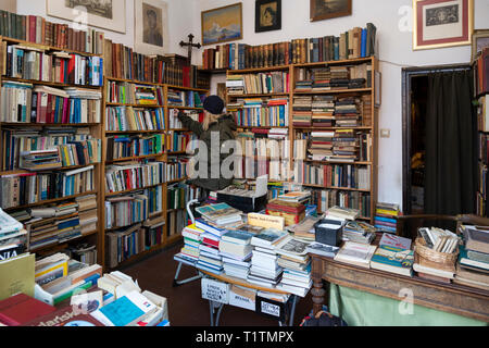 Woman in Second Hand Book Shop, Gdansk, Poland - Stock Image