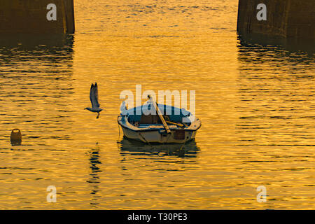 Mousehole, Cornwall, UK. 5th Apr, 2019. UK Weather. A sole dinghy in the harbour at Mousehole this morning. Over the weekend the rest of the boats will be put back in the water ahead of the summer season. Credit: Simon Maycock/Alamy Live News - Stock Image