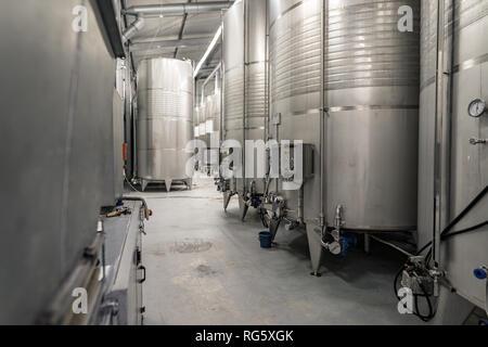 Modern wine making technique, having freezing aluminium tanks with controlled temperature - Stock Image
