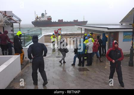 Falmouth, Cornwall, UK. 18th Dec, 2018. The Kuzma Minin bulk carrier ship sits aground on Gyllyngvase Beach with 18 Russian crew members on board waiting for a rescue from the Coast Guard. Strong winds blew the vessel aground at approximately 5:40am. Credit: Stephen Parker/Alamy Live News - Stock Image