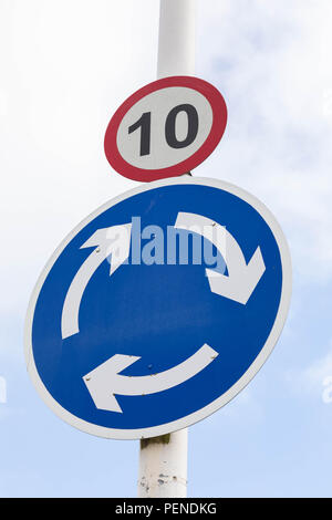 Street sign indicating a speed limit of 10 miles per hour and a roundabout Wrexham Wales June 2018 - Stock Image