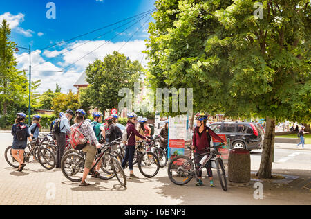 8 January 2019: Christchurch, New Zealand - Group of bicycle tourists gather on a lovely summer day in Christchurch, New Zealand. - Stock Image