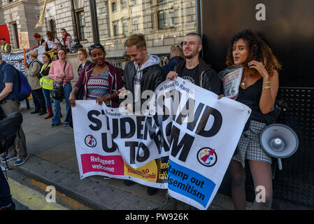 London, UK. 13th October 2018.   Students hold the Student Stand up to Racism banner at the rally in London to oppose racism  and fascism close to where the racist, Islamophobic DFLA were ending their march on Whitehall bringing together various groups to stand in solidarity with the communities the DFLA attacks. The event was organised by Stand Up To Racism and Unite Against Fascism. Peter Marshall/Alamy Live News - Stock Image