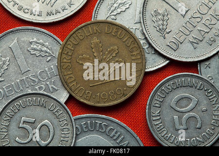 Coins of Germany. Oak sprig depicted in the German 10 pfennig coin. - Stock Image