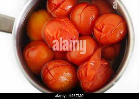 boiled tomato in pot - Stock Image