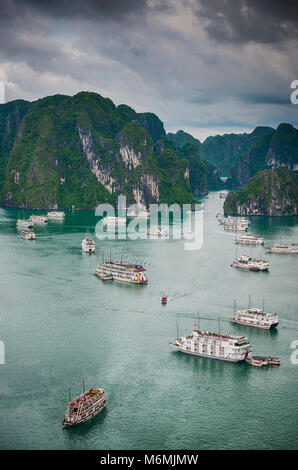 Cruise ships moored in Halong Bay viewed from the top of Titov Island, Vietnam on a stormy day - Stock Image
