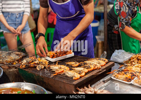 CHIANG MAI, THAILAND - AUGUST 27: Man prepare prawns for sale at the  Saturday night market in Chiang Mai (Walking Street) on August 27, 2016 in Chian - Stock Image