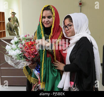 KABUL, Afghanistan (August 29, 2018) -- Sodia (left), an Afghan National Army soldier, poses for a photo after graduating from the Afghan National Army Sergeant Major Academy at Camp Qurgha, Afghanistan, August 29, 2018. She ranked second out of the 80 graduates. (U.S. Army photo by Staff Sgt. Shaiyla Hakeem) - Stock Image