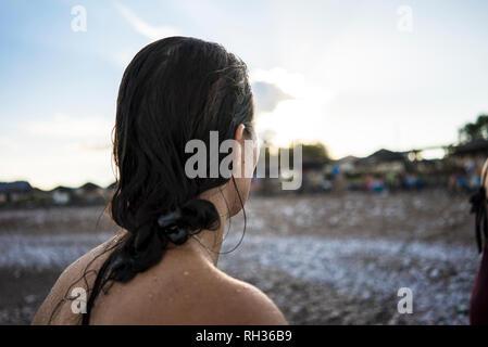 Woman at beach looking away - Stock Image